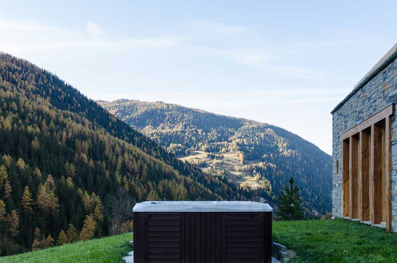 Hot tub outside catered chalet in Peisey-Vallandry