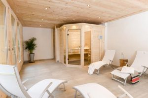 Catered chalet Peisey with spa sauna, leading to hot tub